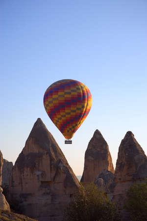 carson ganci: Hot air balloon flying over Goreme valley, Cappadocia, Anatolia, Turkey