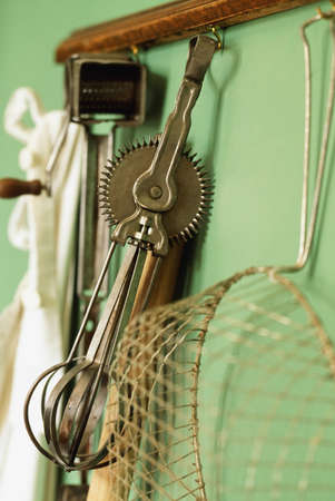Vintage kitchen gadgets hanging on a wall   photo