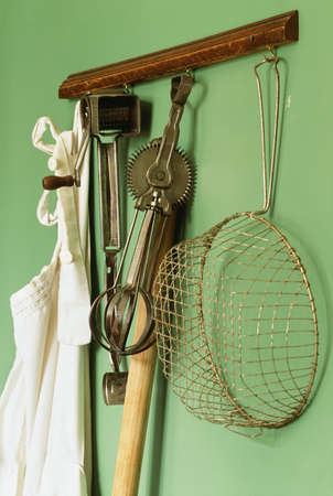 Stock Photo   Vintage Kitchen Gadgets Hanging On A Wall
