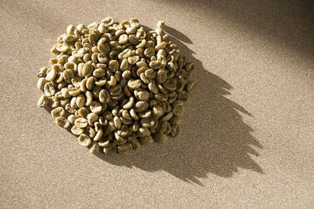 unroasted: Pile of green, unroasted coffee beans Stock Photo