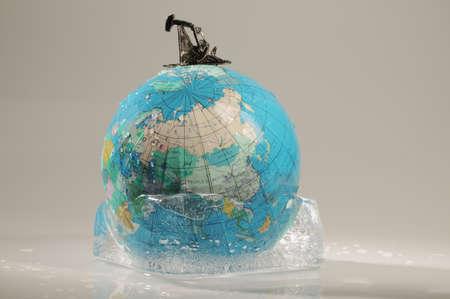 tanasiuk: Globe in ice with oil derek