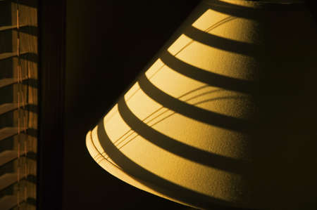 lamp shade: Shadow of blind on lamp shade Stock Photo