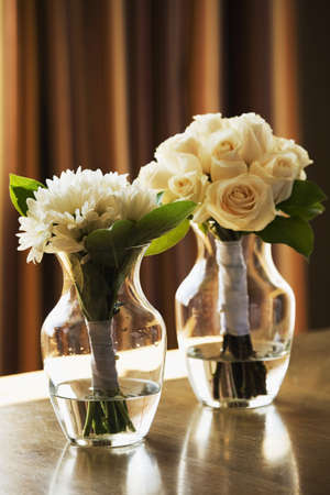 Two vases with flowers photo
