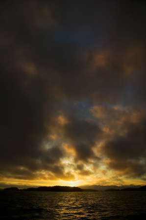 Dark clouds and a sunset Stock Photo - 8241651