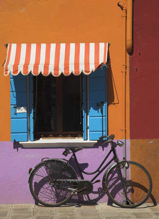 chris upton: Bicycle in Burano, Italy Stock Photo
