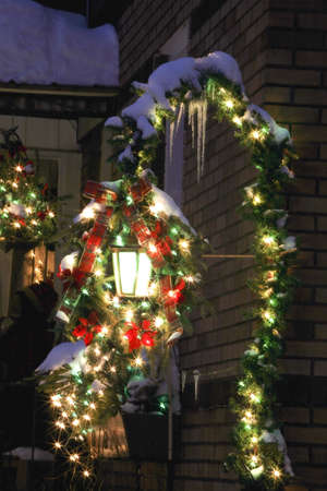 evergreen wreaths: Christmas decorations outside of the house