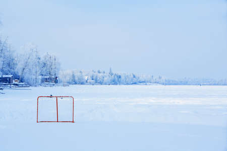 Ice rink on a snowy landscape photo