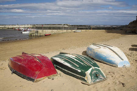 Three overturned boats on the beach,North Yorkshire,United Kingdom