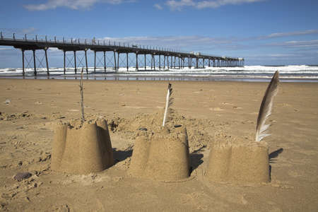 Sand castles by the pier,Saltburn,North Yorkshire,UK