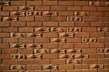 Brick wall with a fish motif,Bridlington,England