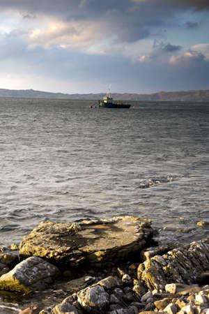 Boat in the water,Loch Sunart,Scotland photo