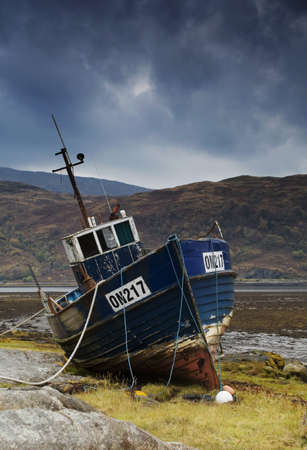 historical periods: Shipwrecked boat in Loch Sunart,Scotland Stock Photo