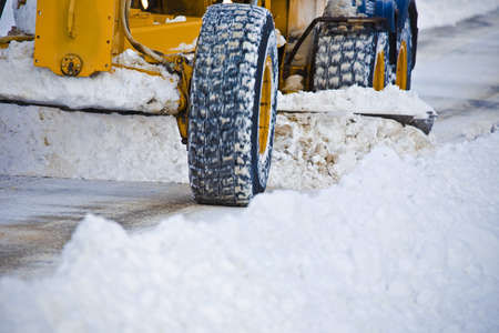 tanasiuk: Snow plow clearing road Stock Photo