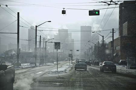 Intersection with traffic going through green light Standard-Bild