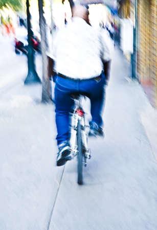 50 something: Rear view of man riding bike