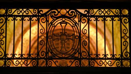Gate silhouette over architecture