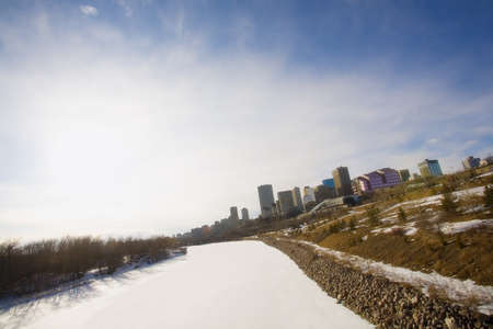 snowcovered: North Saskatchewan River frozen and snow-covered, Edmonton, Alberta, Canada