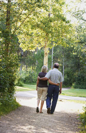 Husband and wife on walking trail Stock Photo - 8245436