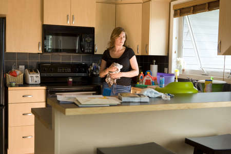 A woman in a kitchen Stock Photo - 8245439