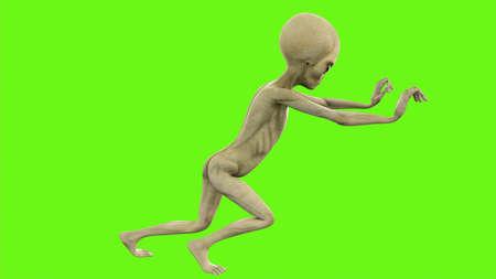 Alien pushing on green screen Stock Photo