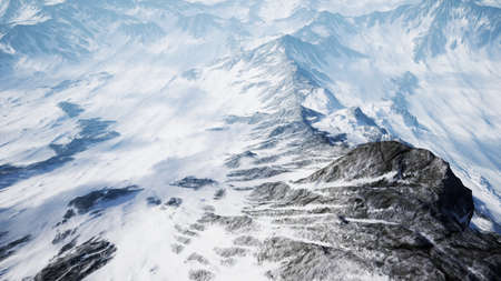 Beautiful Aerial Flight Over Snowy Mountain.