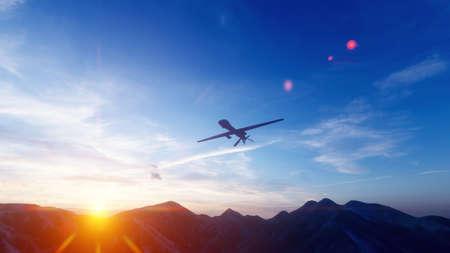 Un drone militaire survole une plaine montagneuse désertique au coucher du soleil.
