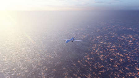 Military drone flies over the ocean at sunrise. The concept of military weapons. Imagens