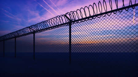 Clouds and a sunset can be seen through the metal prison fence with barbed wire. 3D Rendering