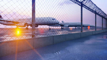 Commercial aircraft at the airport are waiting for departure. 3D Rendering.