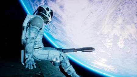 An astronaut sits on the wing of his spaceship and swings his legs looking at the blue planet. 3D Rendering. 写真素材