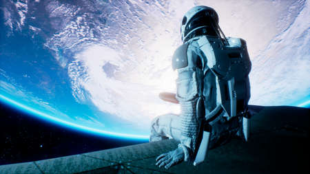 An astronaut sits on the wing of his spaceship and swings his legs looking at the blue planet. 3D Rendering. Stock Photo