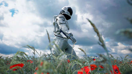 An astronaut-Explorer is walking on a blooming planet. 3D Rendering. Archivio Fotografico