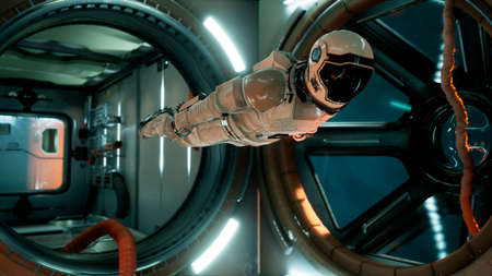 An astronaut in zero gravity checks the module of his spaceship. 3D Rendering. Reklamní fotografie