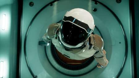 Somewhere in distant space, an astronaut hovers inside his spaceship. 3D Rendering.