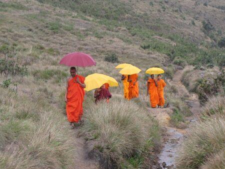priests walking near worldsend at horton plains