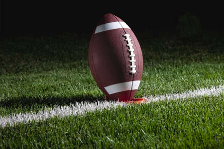 college football: College football on tee at night ready for kick off