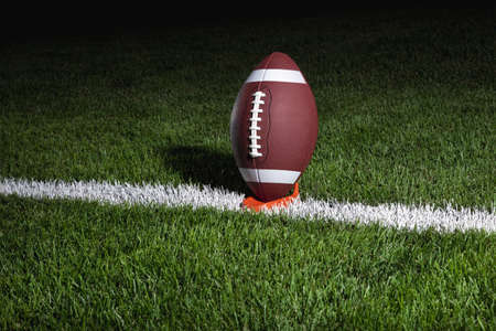 College style football on tee at night ready for kick off Stock Photo - 15145352