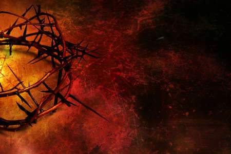 Crown of thorns on grunge background photo