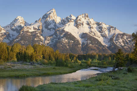 capped: Grand Tetons range with river in morning light