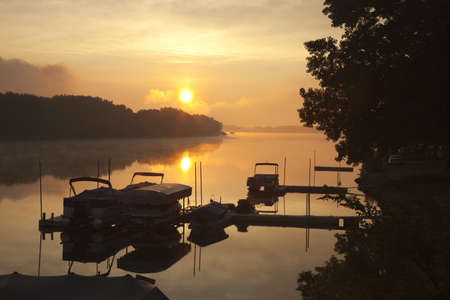 Docks and boats on calm Wisconsin lake at sunrise Stock Photo - 15941405