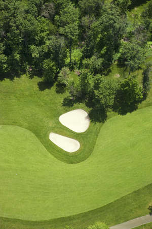 An aerial view of a golf course in Minnesota zoomed in on a fairway and bunkers Stock Photo
