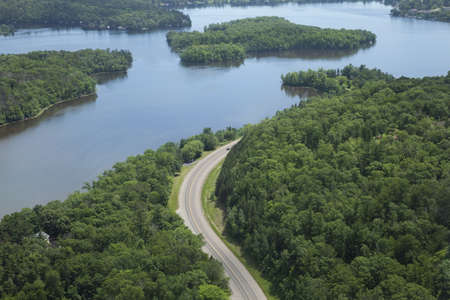 An aerial view of the Mississippi River and a curving road near Brainerd, Minnesota