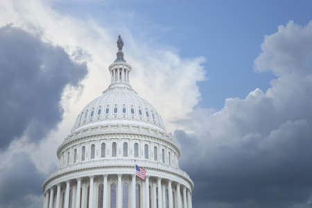 US Capitol dome under stormy skies photo