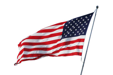 An American flag flying in the breeze isolated on white