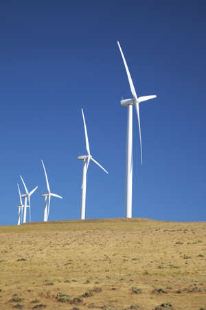 Wind turbines on a hillside along the Columbia River Gorge in Oregon Stock Photo