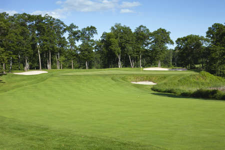 golf flag: Golf fairway and green with trees and bunkers in Minnesota