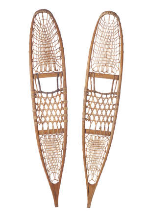 snowshoes: A pair of traditional wood and rawhide snowshoes isolated on a white background Stock Photo