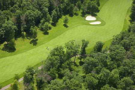 fairway: Aerial view of a golf course fairway in Minnesota with golfers Stock Photo