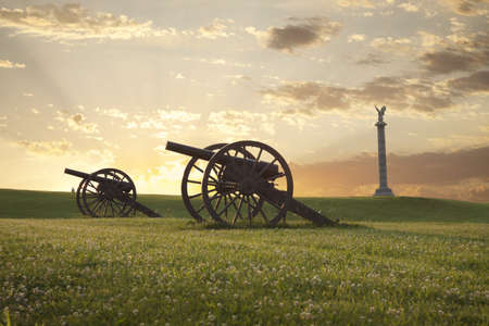 A pair of cannons at sunset on the Antietam National Battlefield near Sharpsburg, Maryland Stock Photo - 18235925
