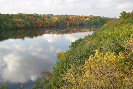 mississippi river: A view of the Mississippi River in the fall with colorful trees near downtown Minneapolis